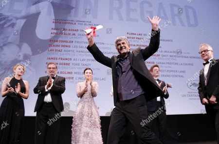 French Director Alain Guiraudie (front C) Receives the Directing Prize For His Movie 'L'inconnu Du Lac' (stranger by the Lake) From Jury Members (rear L-r) Ludivine Sagnier Enrique Gonzalez Macho Zhang Ziyi Thomas Vinterberg and General Delegate of the Festival Thierry Fremaux During the 'Un Certain Regard' Closing Ceremony As Part of the 66th Annual Cannes Film Festival in Cannes France 25 May 2013 France Cannes