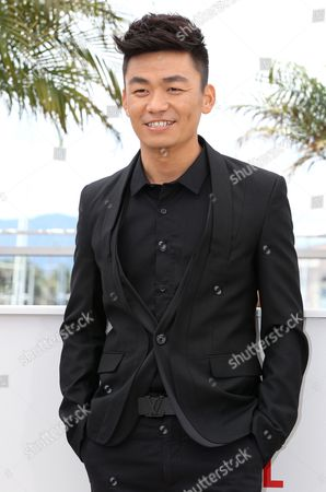 Chinese Actor Baoqiang Wang Poses During the Photocall For 'Tian Zhu Ding' (a Touch of Sin) at the 66th Annual Cannes Film Festival in Cannes France 17 May 2013 the Movie is Presented in the Official Competition of the Festival Which Runs From 15 to 26 May France Cannes