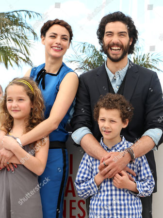 Stock Picture of (l-r) Actress Jeanne Jestin French Actress Berenice Bejo Actor Elyes Aguis and French Actor Tahar Rahim Pose During the Photocall For 'Le Passe' (the Past) at the 66th Annual Cannes Film Festival in Cannes France 17 May 2013 the Movie is Presented in the Official Competition of the Festival Which Runs From 15 to 26 May France Cannes