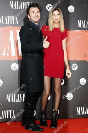 French Humorist Michael Youn (l) and His Partner Isabelle Funaro (r) Pose For the Media Upon Their Arrival For the Premiere of 'Malavita - the Family' at the Europacopr Cinema in Roissy Near Paris France 16 October 2013 France Paris