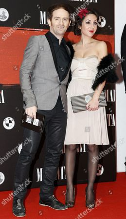 Mathias Malzieu (l) Lead Singer of the French Band Dionysos and an Unidentified Companion Pose For the Media Upon Their Arrival For the Premiere of 'Malavita - the Family' at the Europacopr Cinema in Roissy Near Paris France 16 October 2013 France Paris