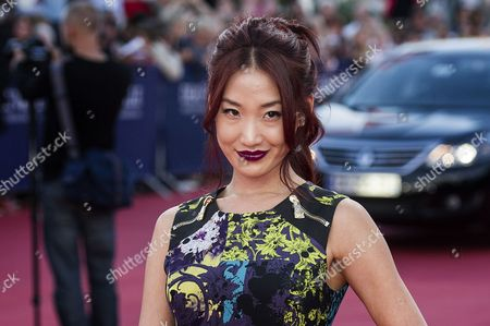 The Wife of Us Actor Nicolas Cage Alice Kim Poses While Arriving For the Screening of 'Joe' During the 39th Annual Deauville American Film Festival in Deauville France 02 September 2013 the Movie is Presented out of Competition As a Premiere at the Festival That Runs From 30 August to 08 September France Deauville