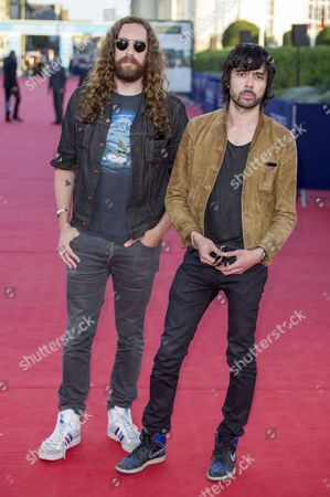 French Musicians of the Group 'Justice' Gaspard Auge (l) and Xavier De Rosnay (r) Pose For the Photographers As He Arrives on the Red Carpet During the 39th Annual Deauville American Film Festival in Deauville France 04 September 2013 the Festival Runs From 30 August to 08 September France Deauville