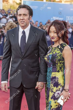 Stock Photo of Us Actor/cast Member Nicolas Cage and His Wife Alice Kim Pose While Arriving For the Screening of 'Joe' During the 39th Annual Deauville American Film Festival in Deauville France 02 September 2013 the Movie is Presented out of Competition As a Premiere at the Festival That Runs From 30 August to 08 September France Deauville