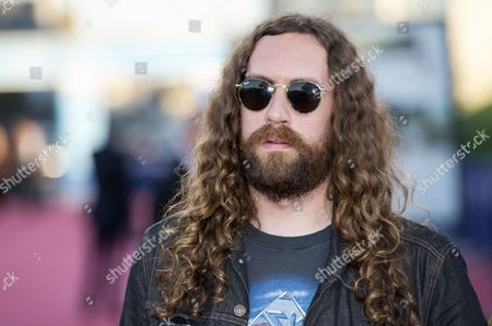 French Musician of the Group 'Justice' Gaspard Auge Poses For the Photographers As He Arrives on the Red Carpet During the 39th Annual Deauville American Film Festival in Deauville France 04 September 2013 the Festival Runs From 30 August to 08 September France Deauville
