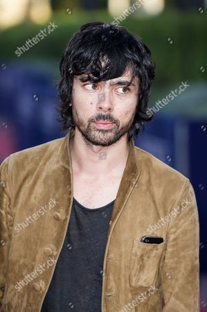 French Musician of the Group 'Justice' Xavier De Rosnay Poses For the Photographers As He Arrives on the Red Carpet During the 39th Annual Deauville American Film Festival in Deauville France 04 September 2013 the Festival Runs From 30 August to 08 September France Deauville