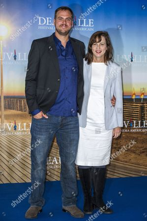 Us Director Jim Mickle (l) and Us Producer Linda Moran (r) Pose at a Photocall For 'We Are what We Are' During the 39th Annual Deauville American Film Festival in Deauville France 06 September 2013 the Movie is Presented in the Official Competition of the Festival That Runs From 30 August to 08 September France Deauville