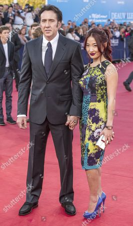 Us Actor/cast Member Nicolas Cage and His Wife Alice Kim Pose While Arriving For the Screening of 'Joe' During the 39th Annual Deauville American Film Festival in Deauville France 02 September 2013 the Movie is Presented out of Competition As a Premiere at the Festival That Runs From 30 August to 08 September France Deauville