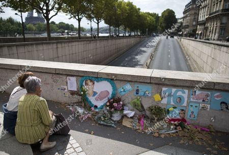 Two People Sit in Front of a Makeshift Memorial of Flowers and Pictures For Britain's Late Princess Diana on the Pont De L'alma Bridge in Paris France 31 August 2013 Today Marks the 16th Anniversary of the Fatal Car Crash That Killed Princess Diana and Her Companion Dodi Al-fayed in the Tunnel Beneath the Alma Bridge France Paris