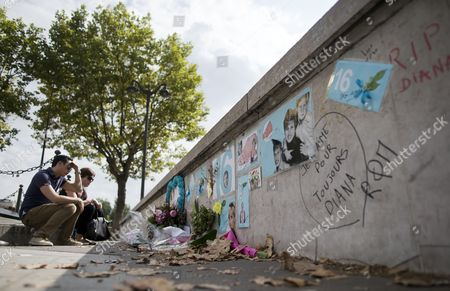 A Couple Sit in Front of a Makeshift Memorial of Flowers and Pictures For Britain's Late Princess Diana on the Pont De L'alma Bridge in Paris France 31 August 2013 Today Marks the 16th Anniversary of the Fatal Car Crash That Killed Princess Diana and Her Companion Dodi Al-fayed in the Tunnel Beneath the Alma Bridge France Paris