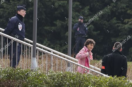 Stock Image of French Cycling Champion and Cast Member of the French Reality Television Show 'Dropped' Jeannie Longo (2-r) Arrives at the Reception Pavilion of Charles De Gaulles Airport in Roissy Near Paris France 14 March 2015 Ten People Including Several French Athletes Were Killed on 09 March 2015 when Two Helicopters Collided in Northern Argentina the Dead Included Both Argentine Pilots and the Cast and Crew of a Reality Television Survival Show Which was to Feature a Celebrity Cast Including Olympic Swimmer Camille Muffat Former Boxer Alexis Vastine and Yachtswoman Florence Arthaud the Identification of the Ten Fatalities From the Collision Will Be Performed by Matching Their Dna with Family Due to Carbonization of the Bodies France Paris