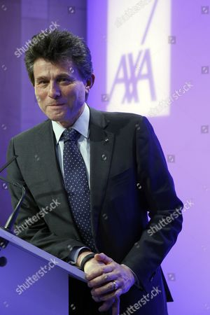 Henri De Castries Chairman and Ceo of Axa Poses For Photographs After Holding a News Conference to Presents the Company's 2014 Results in Paris France 25 February 2015 the Company Has Announced a Net Profit of 5 02 Billions Euros in 2014 Which Represents a 12 Per Cent Increase France Paris