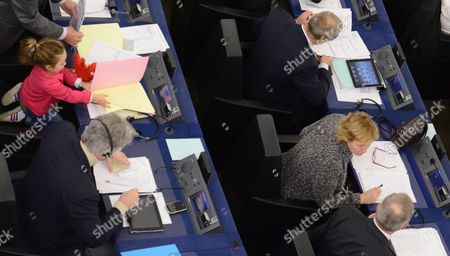 Stock Photo of Vittoria Ronzulli (l) Daughter Licia Ronzulli an Italian Member of the European Parliament Representing the People of Freedom Party Plays with Documents During a Voting Session in the European Parliament in Strasbourg France 19 November 2013 France Strasbourg