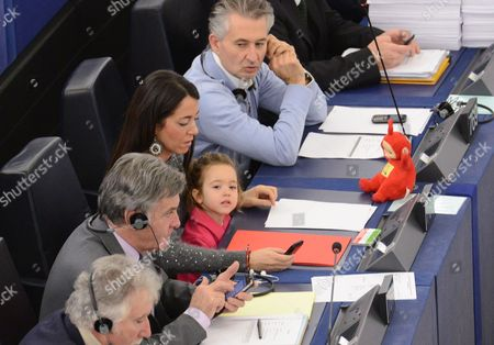 Vittoria Ronzulli (l) Daughter of Licia Ronzulli an Italian Member of the European Parliament Representing the People of Freedom Party Sits on Her Mother's Lap During a Voting Session in the European Parliament in Strasbourg France 19 November 2013 France Strasbourg