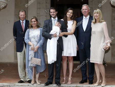 (l-r) Grand Duke Henri and Grand Duchess Maria Teresa of Luxembourg Prince Felix and Princess Claire of Luxembourg with Their Baby Daughter Princess Amalia Gabriele Lademacher and Hartmut Lademacher Pose For Photographers After For the Baptism Ceremony of Princess Amalia Held at the Saint-ferreol Chapel in Lorgues South of France 12 July 2014 the Daughter of Prince Felix and Princess Claire of Luxembourg was Born on 15 June 2014 France Lorgues