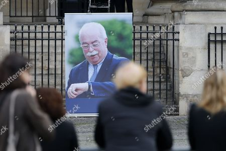 A Portrait of Former Total Ceo Christophe De Margerie is Displayed in Front of Saint Sulpice Church During a Funeral Service in Paris France 27 October 2014 Former Ceo of the Oil Company Christophe De Margerie Died in an Air Crash in Moscow Russia on 21 October 2014 Along with Three Crew Members when a Snowplough Collided with the Plane He was on France Paris