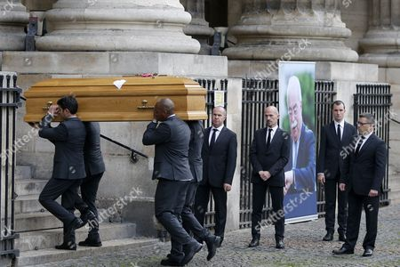 The Coffin of Former Total Ceo Christophe De Margerie is Carried Into the Saint Sulpice Church Prior to a Funeral Service in Paris France 27 October 2014 Former Ceo of the Oil Company Christophe De Margerie Died in an Air Crash in Moscow Russia on 21 October 2014 Along with Three Crew Members when a Snowplough Collided with the Plane He was on France Paris
