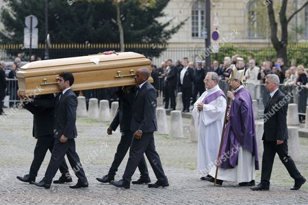 Stock Photo of The Coffin of Former Total Ceo Christophe De Margerie is Carried Into the Saint Sulpice Church Prior to a Funeral Service in Paris France 27 October 2014 Former Ceo of the Oil Company Christophe De Margerie Died in an Air Crash in Moscow Russia on 21 October 2014 Along with Three Crew Members when a Snowplough Collided with the Plane He was on France Paris