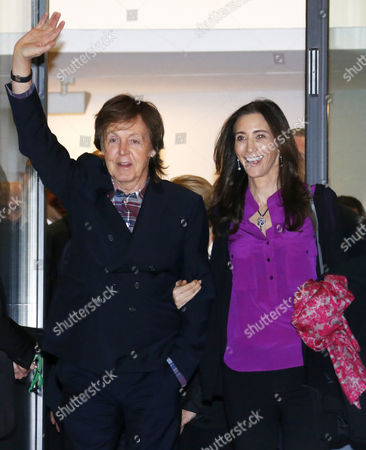 British Musician Paul Mccartney (l) and His Wife Nancy Shevell Greet As They Leave the Exhibition 'Linda Mccartney Retrospective 1965-1997' in Montpellier Southern France 20 February 2014 France Montpellier
