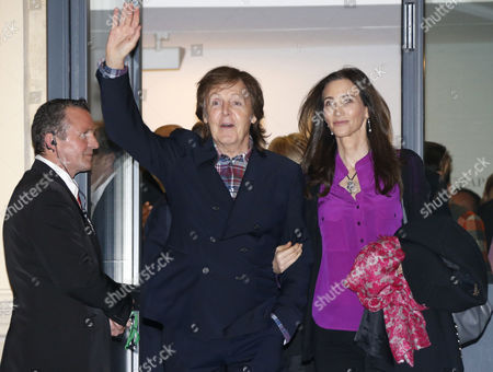 British Musician Paul Mccartney (l) and His Wife Nancy Shevell Leave the Exhibition 'Linda Mccartney Retrospective 1965-1997' in Montpellier Southern France 20 February 2014 France Montpellier