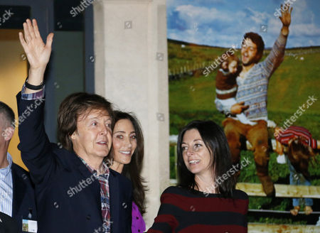 British Musician Paul Mccartney (l) His Wife Nancy Shevell (c) and His Daughter Mary Anna Mccartney (r) Greet As They Leave the Exhibition 'Linda Mccartney Retrospective 1965-1997' in Montpellier Southern France 20 February 2014 France Montpellier