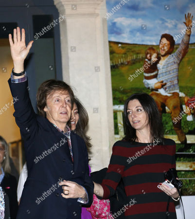 British Musician Paul Mccartney (l) His Wife Nancy Shevell (back-c) and His Daughter Mary Anna Mccartney (r) Greet As They Leave the Exhibition 'Linda Mccartney Retrospective 1965-1997' in Montpellier Southern France 20 February 2014 France Montpellier