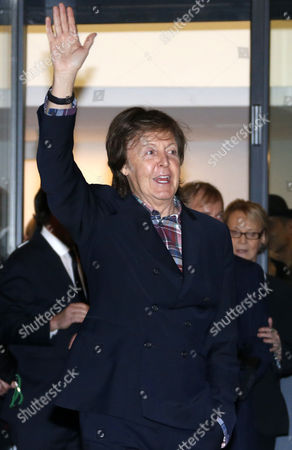 British Musician Paul Mccartney Greets As He Eaves the Exhibition 'Linda Mccartney Retrospective 1965-1997' in Montpellier Southern France 20 February 2014 France Montpellier