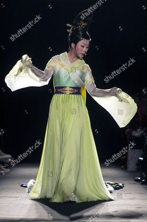 Stock Photo of Chinese Singer Dancer and Female Impersonator Li Yugang Performs Prior to the Presentaion of the Haute Couture Fall-winter 2013/14 Collection by Chinese Designer Laurence Xu During the Paris Fashion Week in Paris France 04 July 2013 the Presentation of the Haute Couture Collections Runs From 30 June to 05 July France Paris