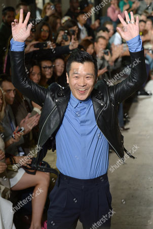 Japanese Designer Arashi Yanagawa Waves on the Catwalk After the Presentation of His Spring/summer 2014 Men's Collection For John Lawrence Sullivan Fashion House During the Paris Fashion Week in Paris France 26 June 2013 the Presentation of the Men's Collections Runs From 26 to 30 June France Paris