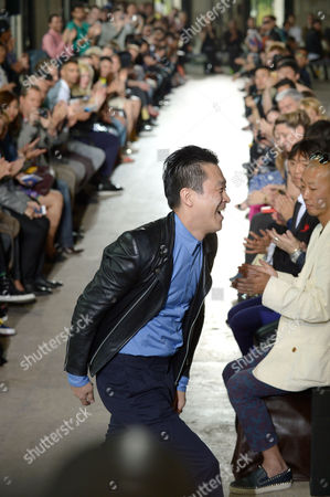 Japanese Designer Arashi Yanagawa Appears on the Catwalk After the Presentation of His Spring/summer 2014 Men's Collection For John Lawrence Sullivan Fashion House During the Paris Fashion Week in Paris France 26 June 2013 the Presentation of the Men's Collections Runs From 26 to 30 June France Paris