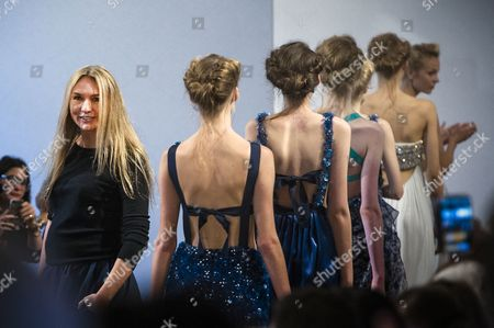 Australian Designer Collette Dinnigan (l) Acknowledges the Public After Her Spring/summer 2014 Ready to Wear Collection Show During the Paris Fashion Week in Paris France 30 September 2013 the Presentation of the Women's Collections Runs From 24 September to 02 October France Paris