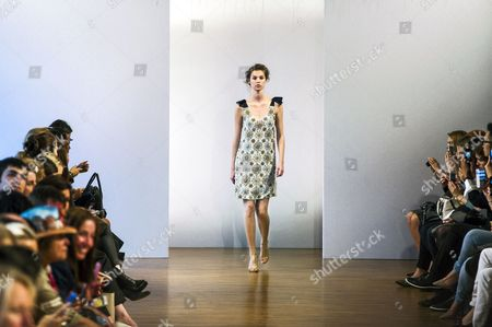 Stock Photo of A Model Presents a Creation From the Spring/summer 2014 Ready to Wear Collection by Australian Designer Collette Dinnigan During the Paris Fashion Week in Paris France 30 September 2013 the Presentation of the Women's Collections Runs From 24 September to 02 October France Paris