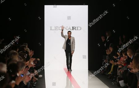 Italian Designer Raffaele Borriello Waves on the Catwalk After Presenting His Spring/summer 2014 Ready to Wear Collection For Leonard Fashion House During the Paris Fashion Week in Paris France 30 September 2013 the Presentation of the Women's Collections Runs From 24 September to 02 October France Paris