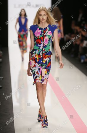 Stock Photo of A Model Presents a Creation From the Spring/summer 2014 Ready to Wear Collection by Italian Designer Raffaele Borriello For Leonard Fashion House During the Paris Fashion Week in Paris France 30 September 2013 the Presentation of the Women's Collections Runs From 24 September to 02 October France Paris