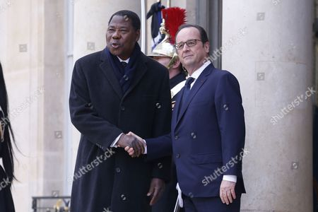 French President Francois Hollande (r) Welcomes Benin President Thomas Yayi Boni (l) at the Elysee Palace Before They Participate in a March to Honor the Victims of the Terrorist Attacks and to Show Unity in Paris France 11 January 2015 Hundreds of Thousands of People and More Than 40 World Leaders Were Expected For the March Honouring the 17 Victims Killed in Three Days of Terror Earlier in the Week Which Started when Gunmen Invaded French Satirical Magazine Charlie Hebdo Continued with the Shooting of a Policewoman and Ended with the Siege of a Jewish Supermarket France Paris