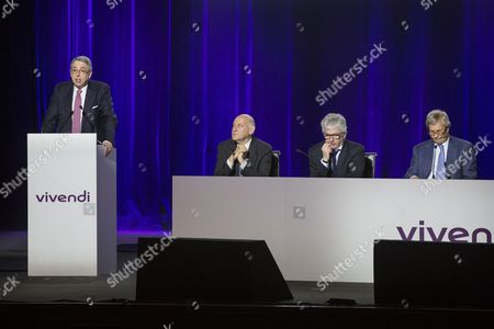 (l) Vivendi Directory President Arnaud De Puyfontaine Delivers a Speech Next to (2-l-r) Vivendi Organization and Development Director Stephane Roussel Vivendi Financial Director Herve Philippe and Chairman of the Supervisory Board Vincent Bollore During Vivendi's General Meeting at the Olympia in Paris France 17 April 2015 France Paris