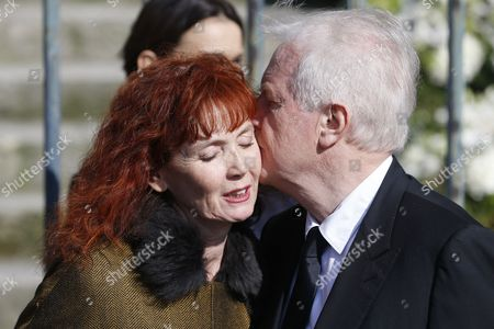 French Actor Andre Dussollier (r) Kisses French Actress Sabine Azema (l) As They Leave the Saint-vincent-de-paul Church After Attending the Funeral of French Director Alain Resnais in Paris France 10 March 2014 Resnais Died at the Age of 91 Years Old France Paris