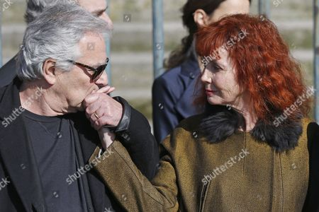 French Actor Pierre Arditi (l) Kisses the Hand of French Actress Sabine Azema (r) As They Leave the Saint-vincent-de-paul Church After Attending the Funeral of French Director Alain Resnais in Paris France 10 March 2014 Resnais Died at the Age of 91 Years Old France Paris