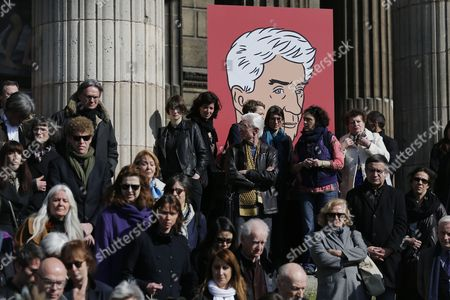 People Leave the Saint-vincent-de-paul Church After Attending the Funeral of French Director Alain Resnais in Paris France 10 March 2014 Resnais Died at the Age of 91 Years Old on the Background the Portrait of French Director Alain Resnais is Displayed Outside the Saint-vincent-de-paul Church France Paris