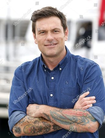 Stock Picture of Canadian Chef and Tv Personality Chuck Hughes Poses During a Photocall at the Annual Mipcom Television Content Market in Cannes France 18 October 2016 the Media Event Runs From 17 to 20 October France Cannes