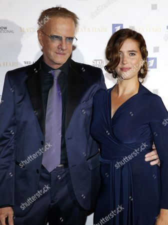 Stock Photo of French Actors Christopher Lambert (l) and Vahina Giocante (r) Pose During a Photocall For the Tv Series 'Mata Hari' at the Annual Mipcom Television Content Market in Cannes France 16 October 2016 the Media Event Runs From 17 to 20 October France Cannes