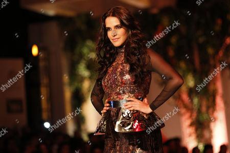Bollywood Actress Neha Dhupia Presents a Creation by Designer Falguni Shane During the India Bridal Fashion Week in New Delhi India 25 July 2013 the Bridal Fashion Week Started on 23 July and Will Continue Till 28 July India New Delhi