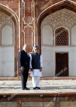 Indian Prime Minsiter Manmohan Singh(r) and His Highness Prince Karim Aga Khan (iv) Pose in Front of Humanyun's Tomb After Its Conservation Inaguration in New Delhi India 18 September 2013 the Restoration of the Architecture was Mainly Funded by the Aga Khan Trust the Mughal Architecture is a World Heritage Site and the First Example of This Type of Mughal Architecture in India Bega Begum Widow of Mughal Emperor Humayun Commissioned the Tomb and It was Built From 1565-1572 India New Delhi