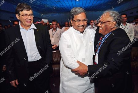 Andre Geim (l) Nobel Laureate For the Year 2010 For Physics From the University of Manchester England Chief Minister of Karnataka Siddaramaiah (c) Gives a Hug to Indian Scientist and Named 'Bharat Ratna' Chintamani Nagesa Ramachandra Rao (r) Before the Inauguration of the 6th Bangalore 'India Nano' at a News Conference in Bangalore 05 December 2013 Over 225 Leading International and Indian Companies and 50 Exhibitors Which Include German United Kingdom Korea and Japan Are Taking Part to Showcase Their Nanoscience Nano Technology Research and Development and Investors Giving an Excellent Platform For Knowledge-sharing Networking and Business India Bangalore