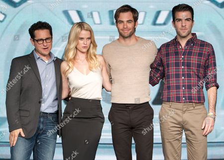 (l-r) Us Director J J Abrams British Actress/cast Member Alice Eve Us Actor/cast Member Chris Pine and Us Actor Zachary Quinto Pose on Stage For Photographers During Press Conference Promoting the Film 'Star Trek Into Darkness' in Tokyo Japan 13 August 2013 the Action Adventure Sci-fi Film Will Be Released in Theaters Across Japan on 23 August Japan Tokyo
