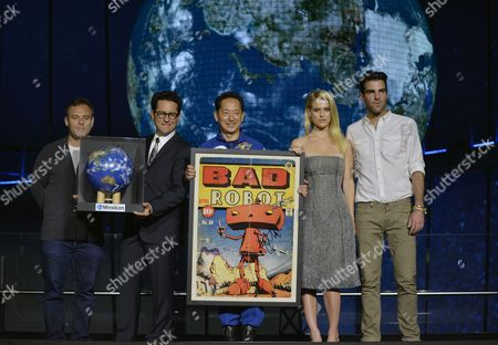 (l-r) Us Producer Bryan Burk Film Director J J Abrams Cast Members British Actress Alice Eve and Us Actor Zachary Quinto Pose with Japanese Former Astronaut Mamoru Mohri (c) During a Promotional Event For the Movie 'Star Trek Into Darkness' at Miraikan (national Museum of Emerging Science and Innovation) in Tokyo Japan 14 August 2013 the Action Sci-fi Movie Will Hit Japanese Theaters on 23 August Japan Tokyo