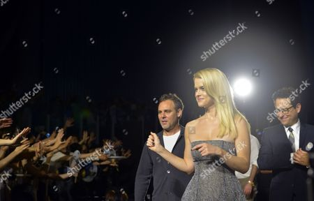 British Actress/cast Member Alice Eve Walks Towards Fans Followed by Us Producer Bryan Burk (l) and Film Director J J Abrams (r) During a Promotional Event For the Movie 'Star Trek Into Darkness' at Miraikan (national Museum of Emerging Science and Innovation) in Tokyo Japan 14 August 2013 the Action Sci-fi Movie Will Hit Japanese Theaters on 23 August Japan Tokyo