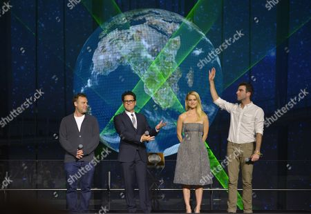 L-r) Us Producer Bryan Burk Film Director J J Abrams and Cast Members British Actress Alice Eve and Us Actor Zachary Quinto Pose For Photographers During a Promotional Event For the Movie 'Star Trek Into Darkness' at Miraikan (national Museum of Emerging Science and Innovation) in Tokyo Japan 14 August 2013 the Action Sci-fi Movie Will Hit Japanese Theaters on 23 August Japan Tokyo