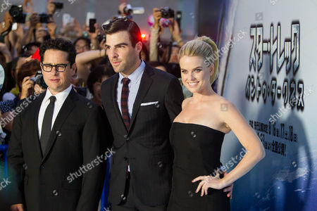 (l-r) Us Director J J Abrams Us Actor Zachary Quinto and British Actress Alice Eve Pose For Photographers During the Premiere of 'Star Trek Into Darkness' in Tokyo Japan 13 August 2013 the Action Adventure Sci-fi Film Directed by J J Abrams Will Hit Japanese Theaters on 23 August Japan Tokyo
