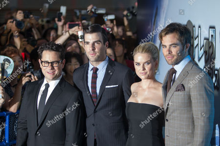 (l-r) Us Director J J Abrams Us Actor Zachary Quinto British Actress Alice Eve and Us Actor Chris Pine Pose For Photographers During the Premiere of 'Star Trek Into Darkness' in Tokyo Japan 13 August 2013 the Action Adventure Sci-fi Film Directed by J J Abrams Will Hit Japanese Theaters on 23 August Japan Tokyo